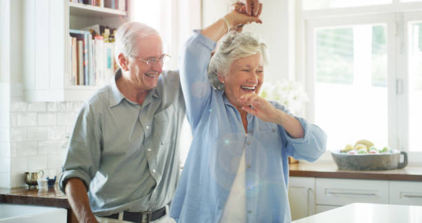 Shot of a happy senior couple dancing together at home